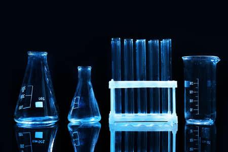 Test tubes and flasks on dark background