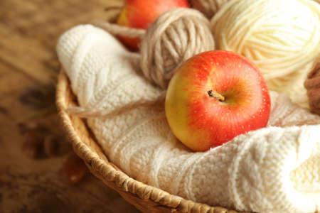 Apple and knitting yarn, closeup Stock Photo