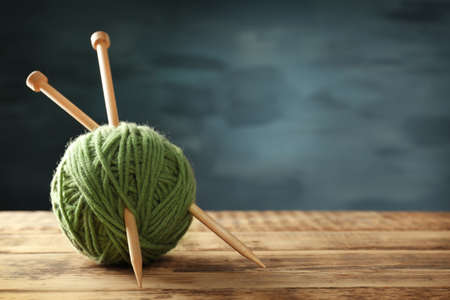 Ball of  knitting yarn on wooden table Stock Photo