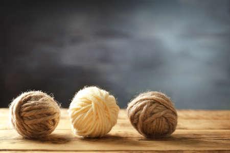 Balls of  knitting yarn on wooden table Stock Photo