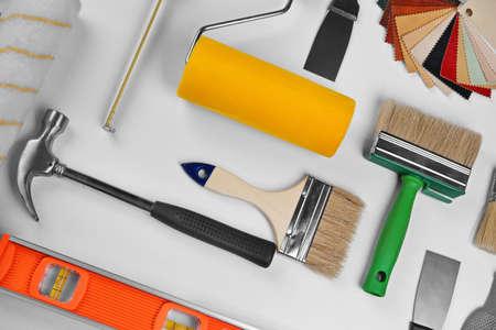 Set of professional decorator equipment on white background
