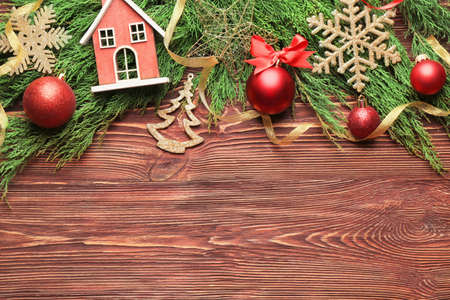 Beautiful composition of Christmas decor on wooden background