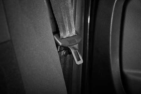Seat belt on black car seat
