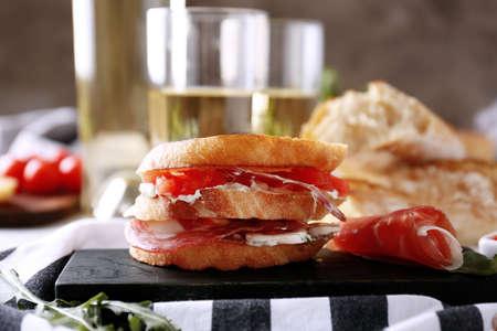Delicious sandwich on wooden board