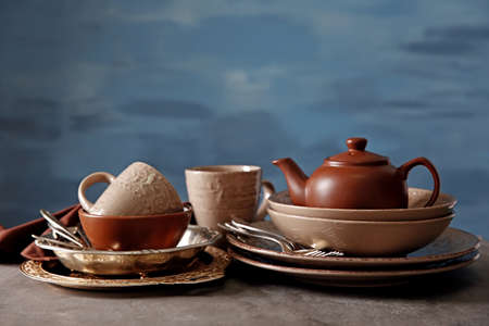 Brown dishware on table and colour background Stock Photo