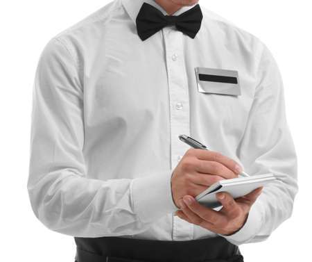 Cute waiter taking an order, close up Stock Photo