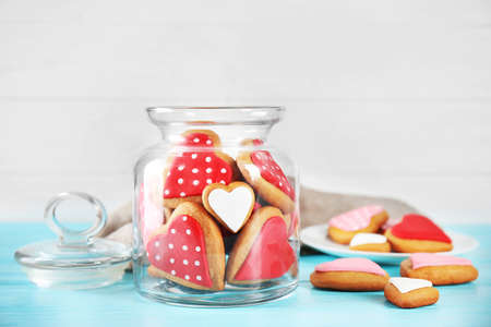 Valentines day cookies in glass jar on light background Stock Photo
