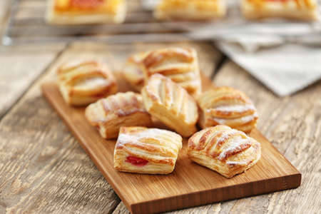 Sweet tasty pastries on cutting board Stock Photo