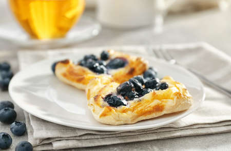 Sweet tasty pastries with bilberries on plate