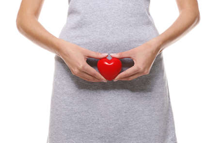 Close up view of woman with red heart on white background. Gynecology concept