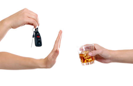 Woman with car key refusing glass of alcoholic beverage, on white background. Dont drink and drive concept