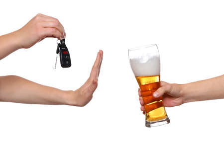 Woman with car key refusing glass of beer, on white background. Dont drink and drive concept