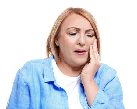 Senior woman suffering from toothache on white background