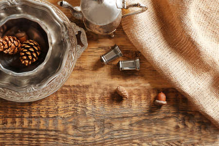 Set of dinnerware on wooden table, top view