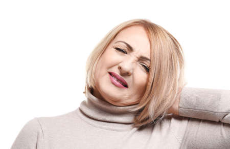 Senior woman suffering from neck pain, on white background Stock Photo