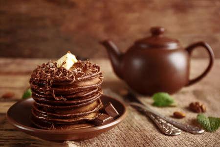 Tasty pancakes with chocolate sauce on plate Stock Photo