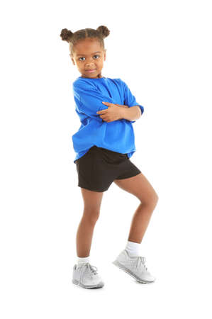 Cute little sportive girl posing on white background Stock Photo
