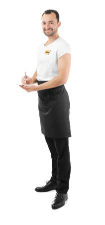 Handsome waiter with notebook and pen on white background