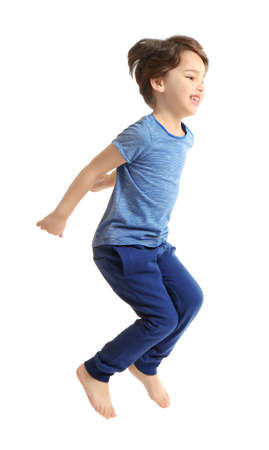 Cute emotional little boy jumping on white background