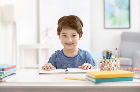 Cute little boy smiling, on blurred background