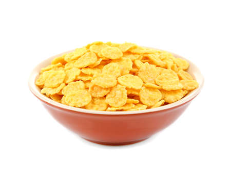 Bowl with cornflakes on white background
