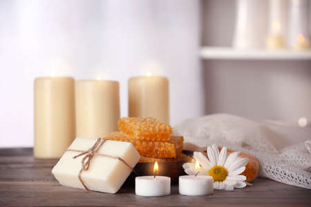 Spa set with honey treatments and candles on wooden table