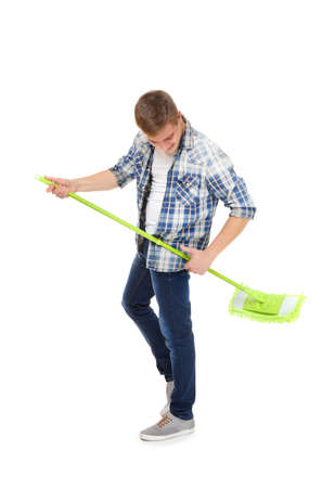 Young service man holding mop on white background Stock Photo