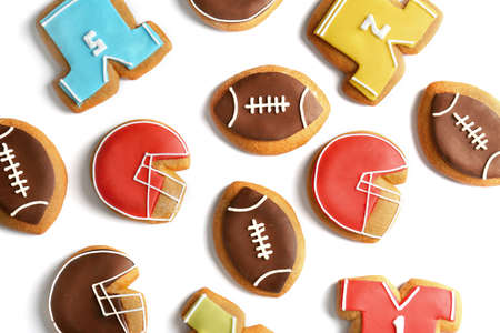 Delicious gingerbread cookies decorated with football signs on white background Stock Photo
