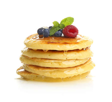 Delicious pancakes with berries and sweet syrup on white background Stock Photo