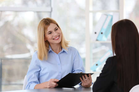 Job interview concept. Human resources manager interviewing woman Stock Photo