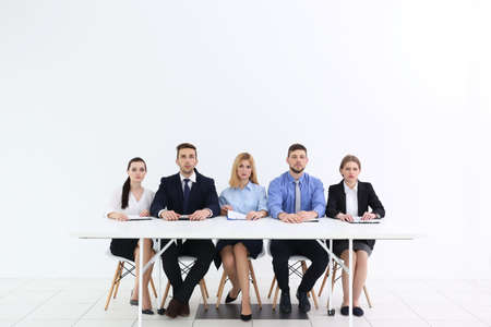Human resources team sitting at table on white background Stock Photo