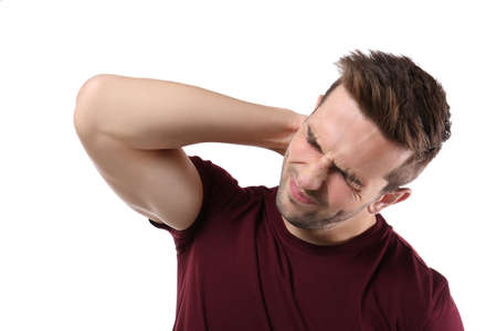 Young man suffering from pain in neck on white background