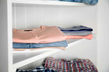 Stack of clothes on shelves