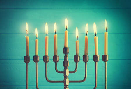 Menorah with candles for Hanukkah on blurred wooden background, closeup Stock Photo
