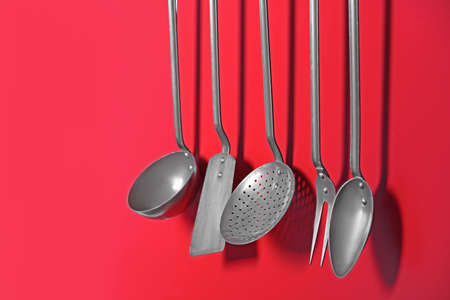 Set Of Metal Kitchen Utensils Hanging On Wall Stock Photo   97286676