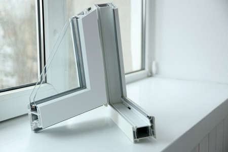 Sample of window profile on windowsill Imagens - 97264391