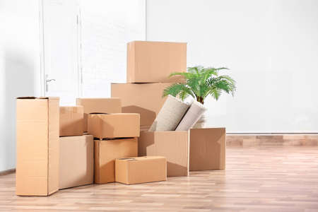 Pile of boxes for moving in office 免版税图像