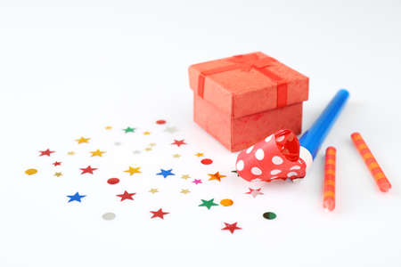 Bright confetti and gift box on white background