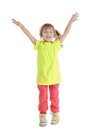 Cute funny girl jumping on white background
