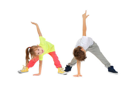 Cute funny children dancing on white background