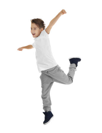Cute funny boy dancing on white background