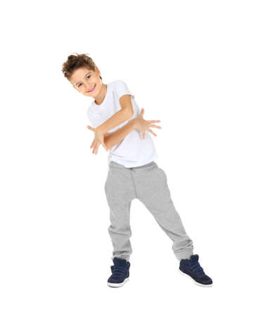 Cute boy dancing on white background Фото со стока
