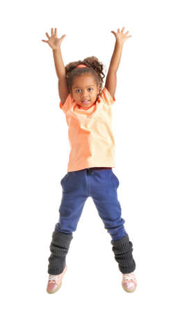 Cute African American girl jumping on white background