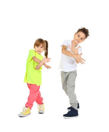 Słodkie śmieszne dzieci tańczą na białym tle Zdjęcie Seryjne