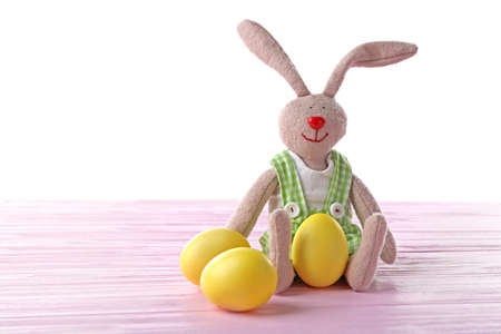 Easter bunny with eggs, on white background