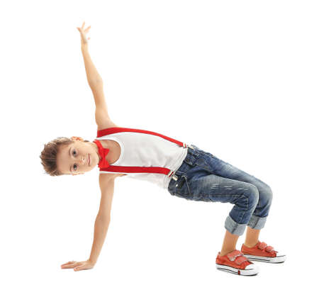Cute little boy dancing on white background