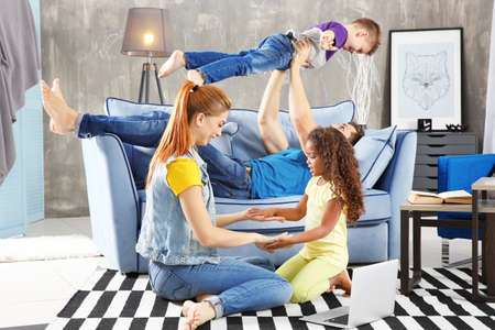 Happy interracial family playing at home
