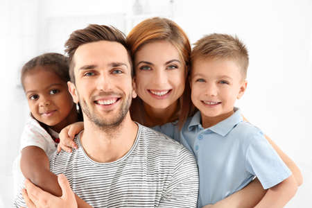 Happy interracial family at home