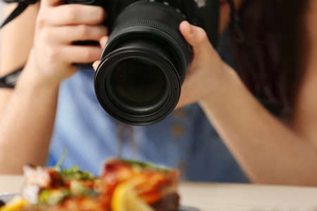 Woman taking closeup pictures of food