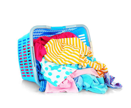Clothes in basket on white background